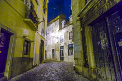 Lisbon at night, streets and old houses of the historic quarter Royalty Free Stock Photo