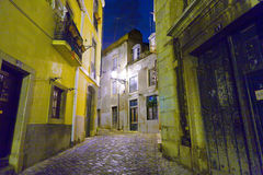 Lisbon at night, streets and old houses of the historic quarter Royalty Free Stock Photos
