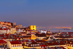 Lisbon Old Town at twilight Stock Images