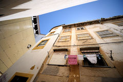 Lisbon oldtown alley. Clothes are drying on Lisbon oldtown alley Royalty Free Stock Photos