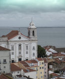 Lisbon. Panorama of the colorful city of Lisbon in Portugal under a threatening sky Stock Photo