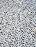 Lisbon pavement background. Detail of a typical portuguese cobblestone hand-made pavement Royalty Free Stock Image