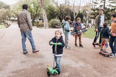 Free Lisbon, Portugal 01 May 2018: Caring Fathers Walk With Their Children And Teach Them To Ride Skateboards And Scooters Stock Photos - 117005813