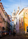 Lisbon, Portugal: Alfama, Rua das Escolas Gerais and towers of São Vicente church Royalty Free Stock Images