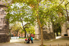 Lisbon, Portugal: Amoreiras park beyond the arches of the old aquaduct Royalty Free Stock Photos