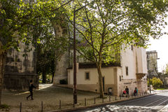 Lisbon, Portugal: Amoreiras street with arches of the aqueduct and the church Royalty Free Stock Photography