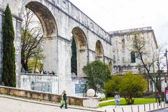 Lisbon, Portugal: Amoreiras street with arches of the aqueduct and the Mãe d'Água reservoir Stock Photography