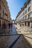Lisbon,Portugal-April 12,2015:Old Lisbon street in a beautiful s Stock Photography