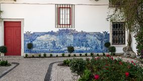 Typical mural with fighting scene, made of blue tiles, at Alfamo district Royalty Free Stock Images