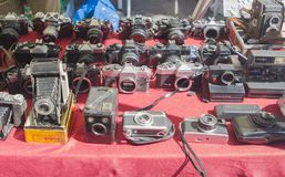 Lisbon, Portugal - August 05, 2017: Collection of old vintage cameras at the flea market royalty free stock photography