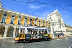 Tram 28 in Commerce Square. Lisbon, Portugal - August 25, 2017: historic yellow Tram 28 in front of Rua Augusta Triumphal Arch in Commerce Square or Praca do Royalty Free Stock Photos