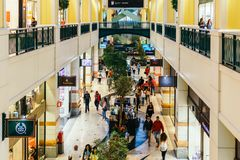 People Crowd Rush For Summer Sale In Shopping Luxury Mall Interior Stock Images