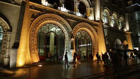 Rossio Station night. Lisbon, Portugal - August 24, 2017: spectacular manueline facade of Rossio Railway Station illuminated at night in Rossio Square, Lisbon stock video