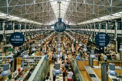 Time Out Market In Lisbon. LISBON, PORTUGAL - AUGUST 12, 2017: Time Out Market is a food hall located in Mercado da Ribeira at Cais do Sodre in Lisbon and is a Stock Photography