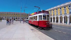 LISBON, PORTUGAL - AUGUST 18, 2017:Touristic red tram. In Commerce Square in Lisbon, Portugal stock video footage
