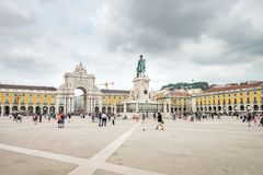 Lisbon, Portugal - August 27, 2017: Tourists walking on the Comercio Square, Praca do Comercio On A Partly Cloudy Day In Lisbon, P stock photography