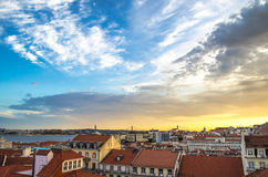 Lisbon, Portugal. Beautiful Lisbon, Portugal with a magnificent sky over the city, along with the April 25th Bridge in the background royalty free stock photo