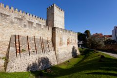 Lisbon, Portugal. Castelo de Sao Jorge aka Saint George Castle. Entrance of the Castelejo aka keep with the moat, watchtowers, battlements, ramparts stock photography
