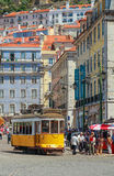 LISBON, PORTUGAL - CIRCA MAY 2014 - Old portuguese traditional electric yellow tram makes its way across central Lisbon streets Royalty Free Stock Image