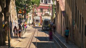 Lisbon Portugal classic tram summer cable car. Lisboa fast stock video