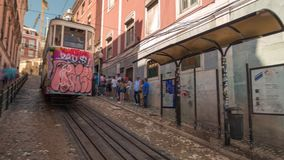 Lisbon Portugal classic tram summer cable car. Lisboa fast stock footage