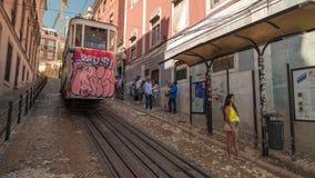 Lisbon Portugal classic tram transport car summer street road traffic. Fast movement stock video