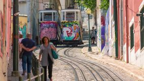Lisbon Portugal classic tram transport summer street road traffic. Lisbon Portugal classic tram transport summer street stock video footage