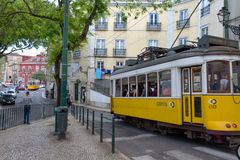 Lisbon, Portugal. Classical yellow tram. In the dowtown. Portuguese destination Stock Image