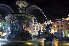 View of the Rossio Square Praca D. Pedro V in the city of Lisbon at night. royalty free stock photography