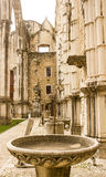 Lisbon, Portugal: detail of Carmo church and convent ruins. Detail of the Carmo church and convent ruins in Lisbon, Portugal. Can be seen a baptismal font and Royalty Free Stock Photo