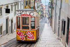 Lisbon, Portugal, Europe - Bairro Alto street. Lisbon, Portugal, Europe - View from Bairro Alto tramway street on a cloudy day with shadows of people passing ( Royalty Free Stock Image