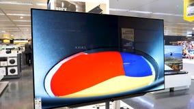 Luxury premium Loewe Bild 5 OLED television. LISBON, PORTUGAL - FEB 10, 2018: Luxury premium Loewe Bild 5 OLED Organic Light-Emitting Diode tv television rich stock video footage