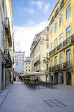 Lisbon, Portugal. FEB 19: Romantic street in the city center, Lisbon on Feb 19, 2014.The Pombaline Lower Town (Baixa Pombalina or Baixa) comprises the grid of Stock Photography