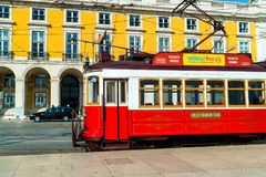 Vintage street car in the old city centre of Lisbon. LISBON , PORTUGAL - FEBRUARY 9, 2018: Vintage red and white tram on the street of Lisbon, Portugal Stock Photography