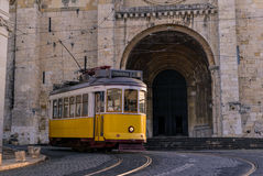 LISBON, PORTUGAL - FEBRUARY 01, 2016: An vintage yellow tram pas Stock Images