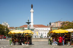 Lisbon, Portugal: general view of Rossio with its popular sales women of flowers, the floristas Royalty Free Stock Photography
