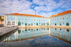 Historic palace with reflection in water in the historic center of Lisbon in Portugal. royalty free stock images