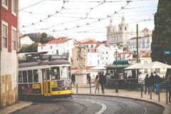 LISBON, PORTUGAL - JANUARY 16, 2018:Lisbon yellow tram on the way. Famous vintage tourist travel attraction on summer day. Colorfu. L architecture city buildings Royalty Free Stock Image