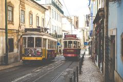 LISBON, PORTUGAL - JANUARY 16, 2018:Lisbon yellow tram on the way. Famous vintage tourist travel attraction on summer day. Colorfu. L architecture city buildings Stock Photos