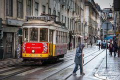 LISBON, PORTUGAL - January 31, 2011: The mythical tram line 28 through the historical center of Lisbon. LISBON, PORTUGAL - January 27, 2011: The mythical tram Stock Photo