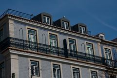 Old building facade with Lisbon traditional tiles. Lisbon. Portugal. January 24, 2018. Old building facade with Lisbon traditional tiles stock photo