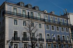 Old building facade with Lisbon traditional tiles. Lisbon. Portugal. January 24, 2018. Old building facade with Lisbon traditional tiles stock photography