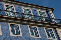 Old building facade with Lisbon traditional tiles. Lisbon. Portugal. January 24, 2018. Old building facade with Lisbon traditional tiles stock photos