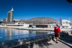 LISBON, PORTUGAL - January 31, 2011: Running near the Vasco da G. Ama tower in the area around the Park of Nations, created for Expo 1998, Lisbon. Portugal, 20th Stock Photography