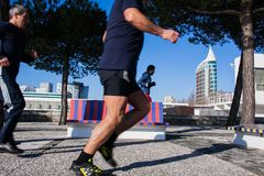 LISBON, PORTUGAL - January 31, 2011: Running near the Vasco da G. Ama tower in the area around the Park of Nations, created for Expo 1998, Lisbon. Portugal, 20th Stock Images