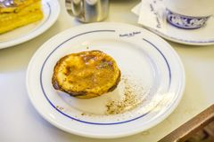 Traditional portuguese pastry and coffee in famous Pasteis de Be. Lisbon, Portugal - January 31, 2018: Traditional portuguese pastry and coffee served in famous Royalty Free Stock Image