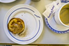 Traditional portuguese pastry and coffee in famous Pasteis de Be. Lisbon, Portugal - January 31, 2018: Traditional portuguese pastry and coffee served in famous Stock Photos