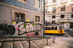 Lisbon, Portugal - January 18, 2016 - Typical Romantic Lisbon st. Reet with  graffiti and azulejos on the background. Vintage effect Stock Images