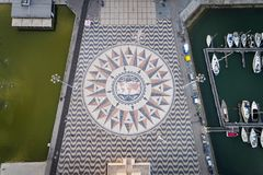 Aerial view of the marble mosaic with the compasse rose at the foot of the Monument to the Discoveries in the city of Lisbon. Stock Image