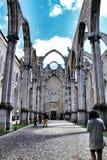 Arcades, pillars and facade of Do Carmo convent in Lisbon. Lisbon, Portugal- June 6, 2018: Arcades, pillars and facade of Do Carmo convent in Lisbon, Portugal Stock Photography